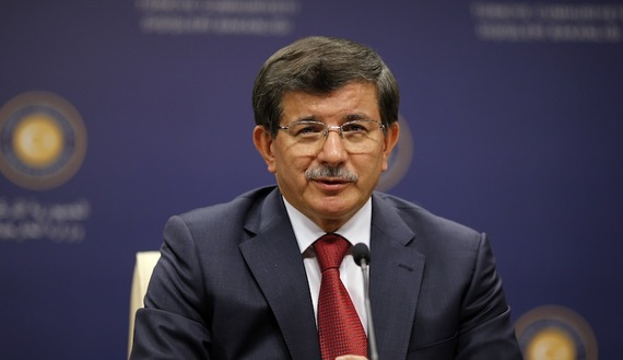 Turkey's Foreign Minister Ahmet Davutoglu addresses the media in Ankara